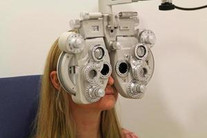 Eye examination with a phoroptor photo