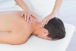Physiotherapist doing neck massage to her patient