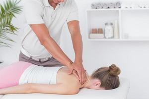 Physiotherapist doing neck massage