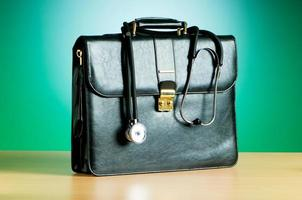 Doctor's case with stethoscope against colorful background photo