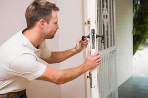Handyman testing the door handle photo