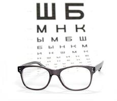 Glasses and test chart for the eye photo