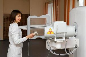 Roentgenographer checks readiness digital X-ray machine to the work photo