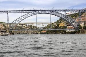 View of Dom Luiz Bridge and Gaia riverbank, Porto cityscape.