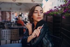 beautiful glamorous brunette smoke electronic cigarette