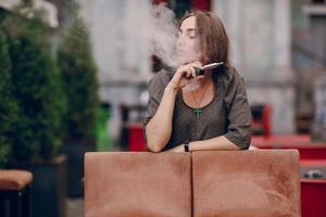 girl with E-cigarette photo