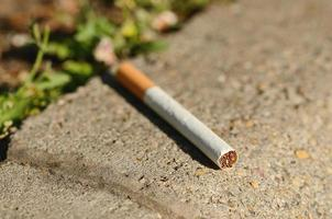 Cigarette on asphalt