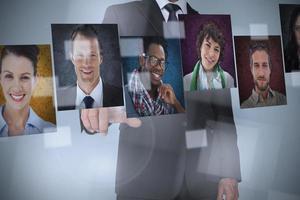 Businessman presenting profile pictures photo