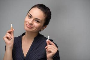Addiction. Closeup of young attractive woman breaking cigarettes