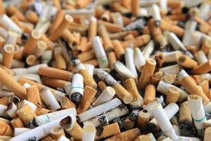 many cigarette butts for backgrounds photo