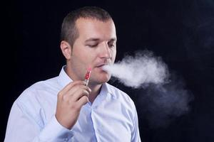 Men smoke an electronic cigarette