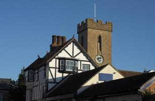 church clock tower with timber building photo