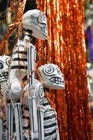 hanging skeletons on mexican market photo