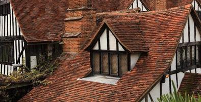 english tudor half timbered building with terracotta roof tiles photo