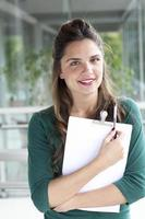 Young woman with clipboard photo