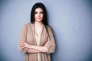 Portrait of attractive young woman with arms folded