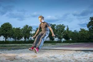 long jump of teen boy photo