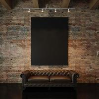 Photo of black empty canvas on the natural brick wall