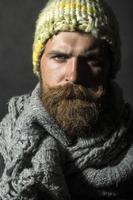 Portrait of gloomy homeless man