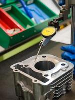 operator inspection automotive parts by high gauge photo