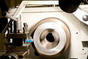 Steel on lathe in machine shop photo