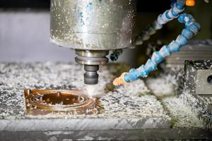 CNC drilling machine in a modern plant making plastic detail photo