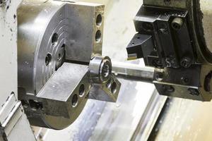 Turning automotive part by cnc lathe photo