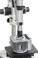operator inspection machining surface of body cylinder by microscope photo