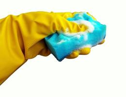 Cleaning sponge and protective rubber gloves photo