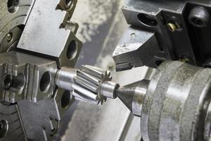 Operator machining automotive gear