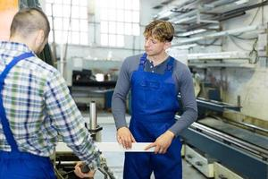 Couple of workmen at factory