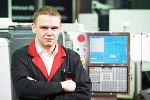 service engineer at machining tool workshop photo