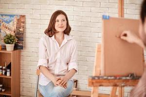 Posing for artist
