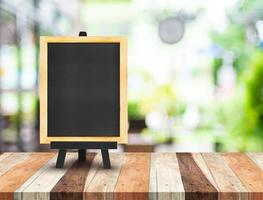 Blackboard menu with easel on wooden table