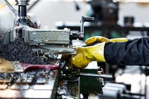 worker operating drilling machine in factory photo
