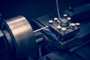 Lathe machine operates on steel rod.