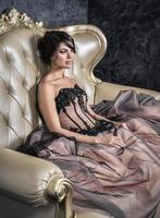 Brunette in a ball gown.
