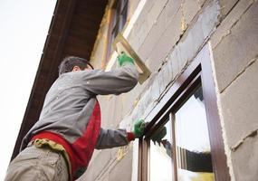Man plastering photo
