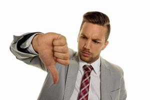 businessman pointing with thumbs down photo