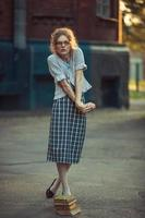 Funny girl with glasses and a vintage dress