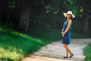 Attractive young adult woman in outdoor blue dress