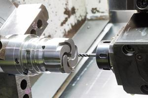 operator machining die casting machine parts photo