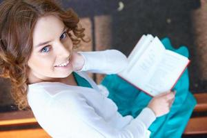 Young woman reads book. photo