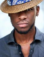 Stylish young african american man with hat photo