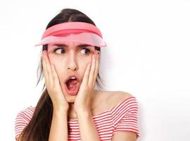 Surprised young woman with mouth open photo