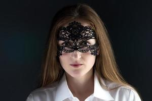 Photo of cute woman in lace mask