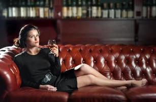 Young woman with a glass of brandy photo
