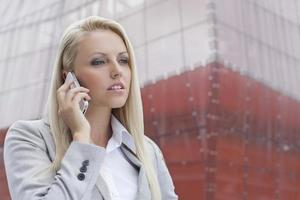 Close-up of blond businesswoman on mobile phone