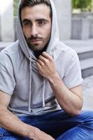 Thoughtful man in hoodie photo