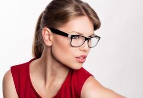 Young woman wearing glasses on white background